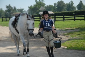 A rider heads to her Turnout Inspection.